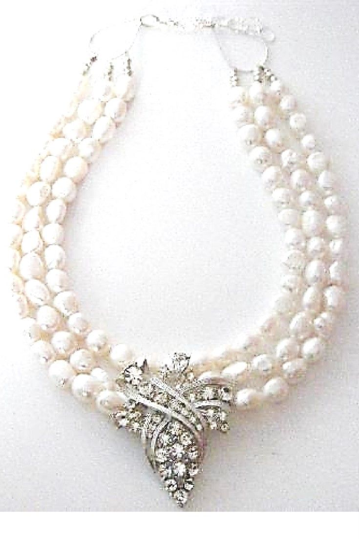 White freshwater pearl & Vintage Rhinestone brooch necklace.  One-of-a-kind statement necklace handmade with white freshwater pearls paired with vintage brooch $260,00. #handmadenecklace#statementnecklaces#necklaces #freshwaterpearl