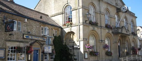 Corsham, UK. High Street is adorable. Combination of eateries, charity shops, the bookstore, and a variety of trails to walk I absolutely loved staying here.