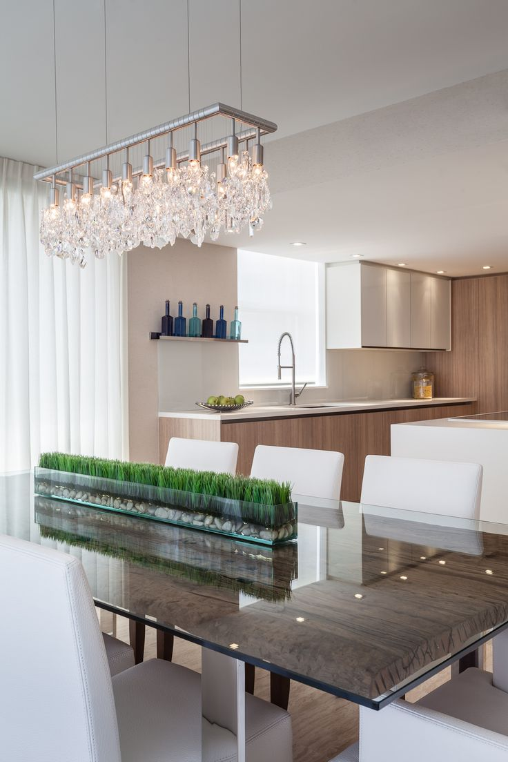 Project by 2id interiors - South Beach    Contemporary Elegant Cozy Beach Dining room. Custom made Ornare Kitchen. Beautiful salvage wood dining table by Artefacto.  Cellula Chandelier with Swarovski® crystal pendants.