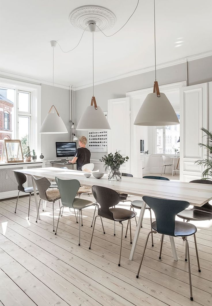 Bright and nice - Collection of Arne Jacobsen chairs around homemade tabletop with table legs from Hay. The lights above the table is from Nordlux while bowls are purchased at the Vitra Museum.