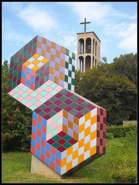 The composition of Victor Vasarely (who was born Győző Vásárhelyi in Pécs) dating from 1977, in front of the Pauline Church. Its parts were made in the Zsolnay Porcelain Factory of Pécs from 15 types of colourful tiles.  You can see the 26 metres high Discover the coolest   shows in     NYC on https://www.artexperiencenyc.com