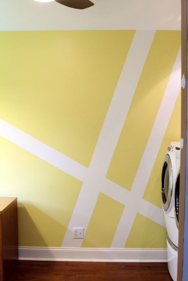 Geometric Wall Mural Laundry Room Makeover | interesting idea. would be very cool with tonal colours or the same colour in different finishes.