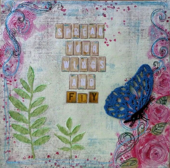 Used micro beads with A2Z chipboard on the butterfly. Modeling paste and paint using a stencil from my stash.