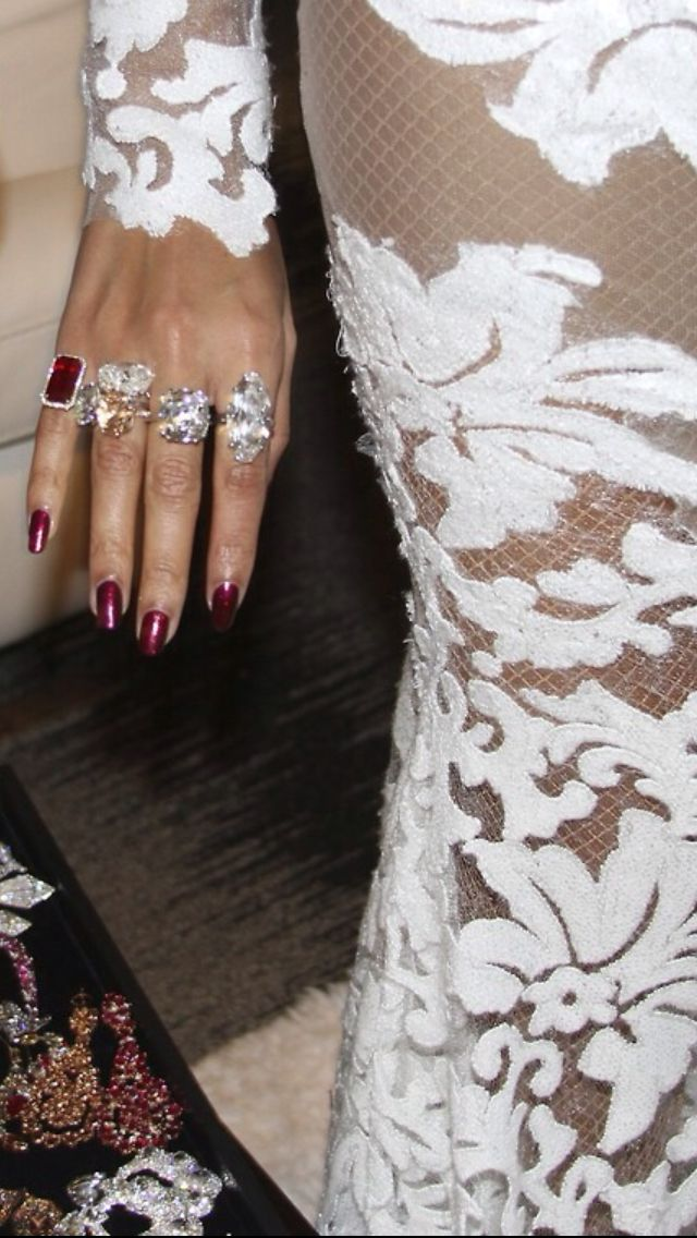 Beyonce in a stunning nude and white lace Michael Costello gown, Christian Louboutin shoes, Lorraine Schwartz jewelry and oxblood nails at the 2014 Grammy Awards, Jan. 26, 2014