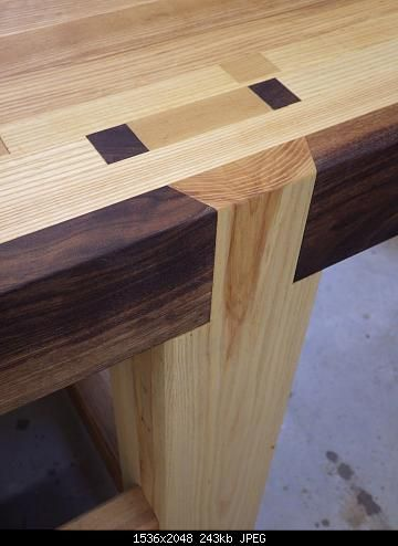 NC Woodworker forum member's handmade workbench. Leg tenon detail, ash and walnut