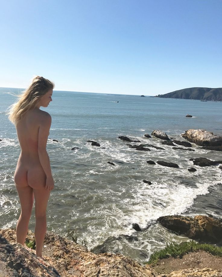 """adventurebuns1: """"From Pirate's Cove Beach comes this #beautiful pic of @lilly.tho enjoying the day! We love how she's looking over her shoulder and just look at the ocean and rocks! Quite a view. We were also told by @lilly.tho that this beach is..."""