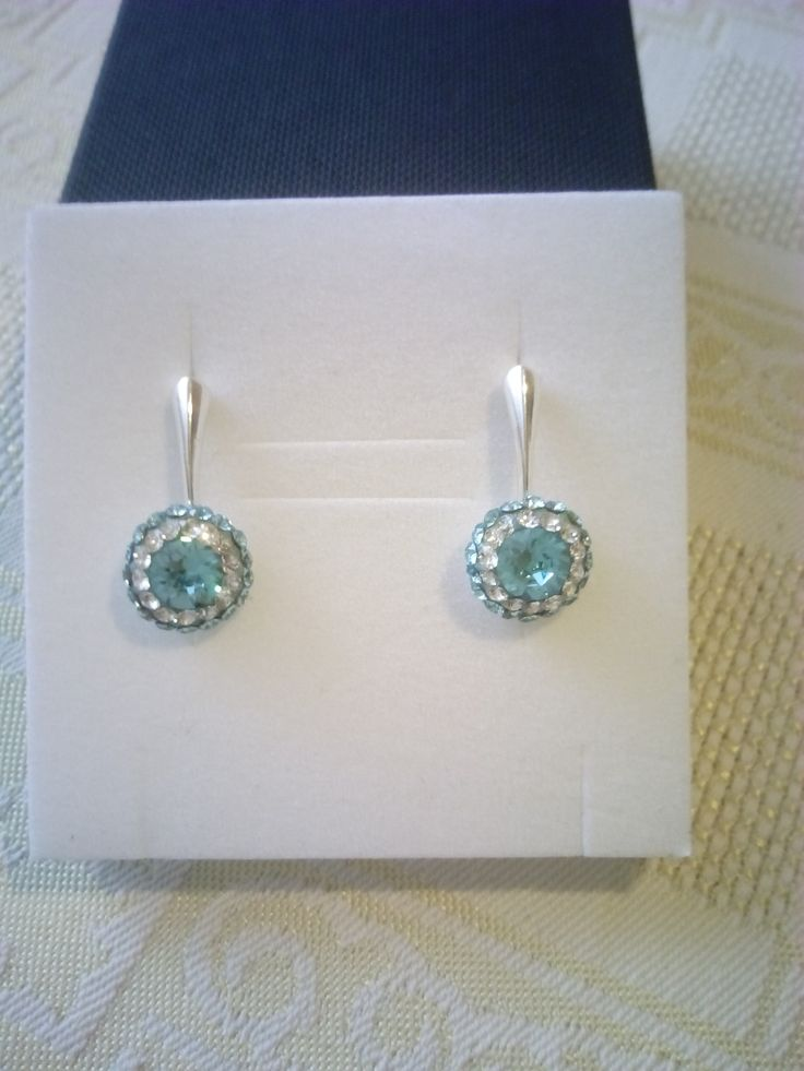Silver earrings with Swarovski crystals in Ceralun construction.