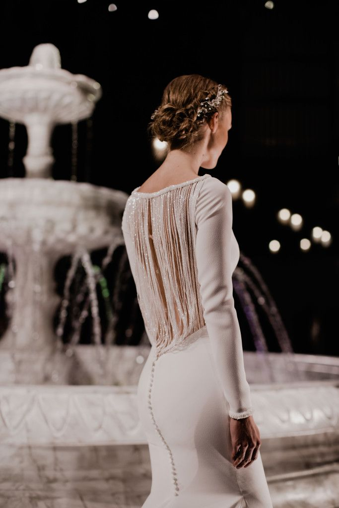 Wedding Day Hairstyles and Inspiration - a simple yet dazzling up-style hair style with some hairpiece detail that leaves a sparkle wherever you go. Wedding dress and hair accessory by international designer, Pronovias