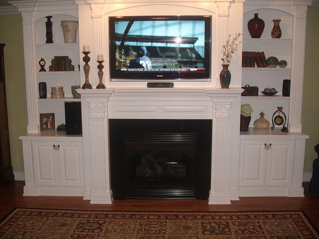 Built-in Entertainment Center/ Mantel with gas insert and Granite Surround by 07reb, via Flickr