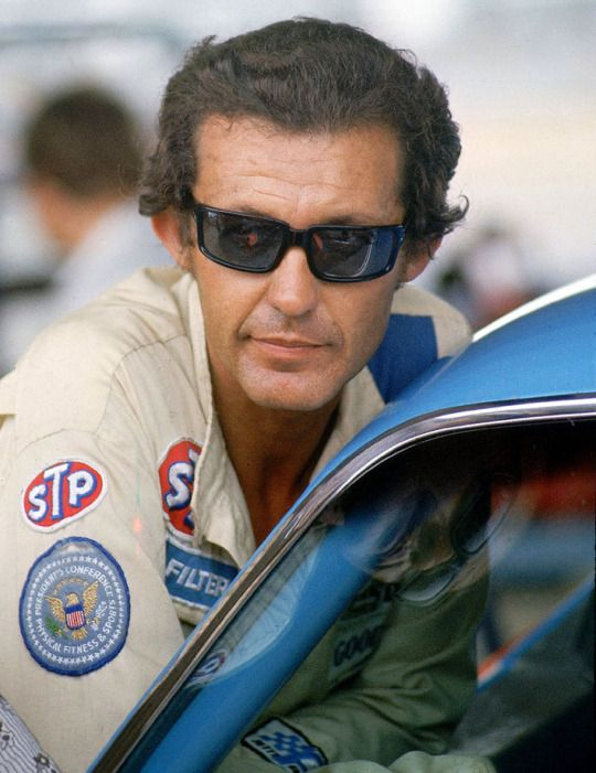 """Richard Petty leans into his car before the Talladega 500 at Alabama International Motor Superspeedway on Aug. 11, 1973. The winningest driver in NASCAR history and seven-time Daytona 500 champ, """"The King"""" turned 78 years old 7/2/15."""
