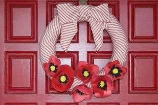 Poppy wreath. The buddy poppy is the official memorial flower of the Veterans of Foreign Wars of the United States. Honor our vets!