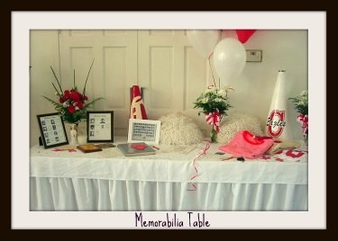 A memorabilia table that showcases things important your guest of honor can be a fun party decoration.