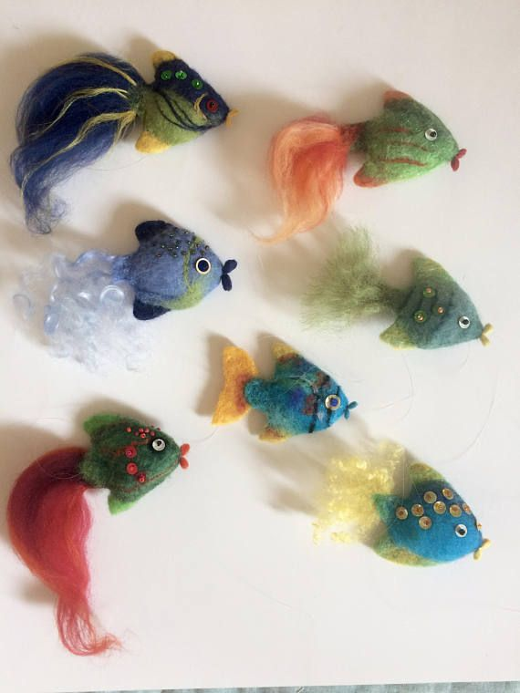 Needle felted green and blu fish. The size of the fish is 2 (5cm) (without tail) The price is for one piece.