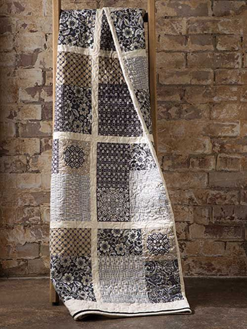 An irresistible combination of textures and colors creates a striking quilt. Use traditional colors and elegant textures to make up a handsome quilt. It's