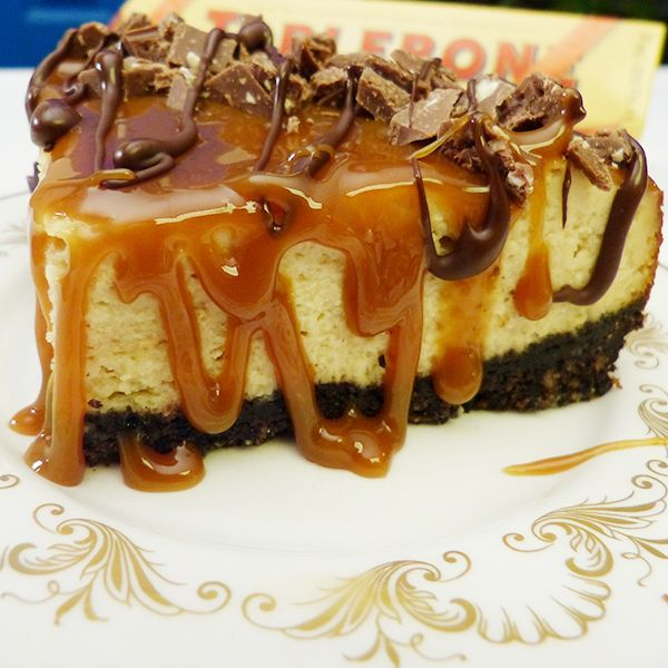 This Toblerone Caramel Cheesecake recipe has a chocolate pecan crust and is ooey gooey delicious.