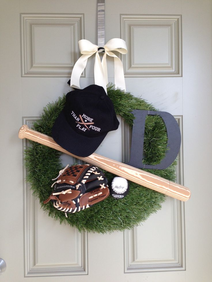 Baseball Wreath. Hat, glove, baseball, bat & initial added to a grass wreath. I think I would do a smaller version.