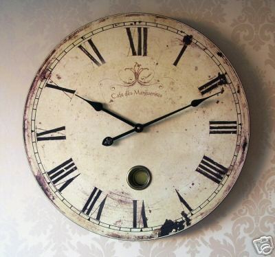 "This fabulous French style wooden wall clock looks great; 23"" diameter with roman numerals. Aged look with moving pendulum."