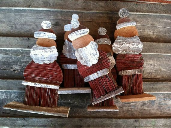 Hand cut wooden Santas built from reclaimed
