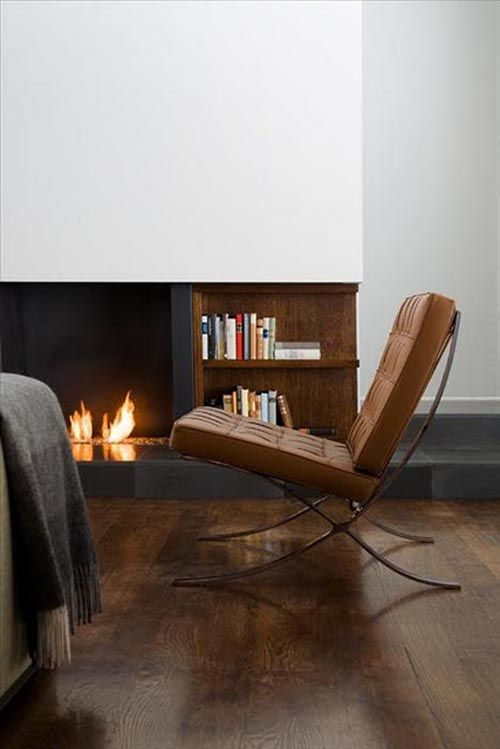 Low niche fireplace with slate hearth and built in shelves