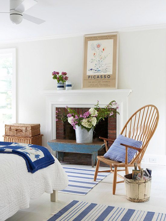 """Country style in a """"less-is-more"""" mode.  I love the Picasso poster with the quilt and bench.  I'm crazy for modern ceiling fans and striped rugs, too."""