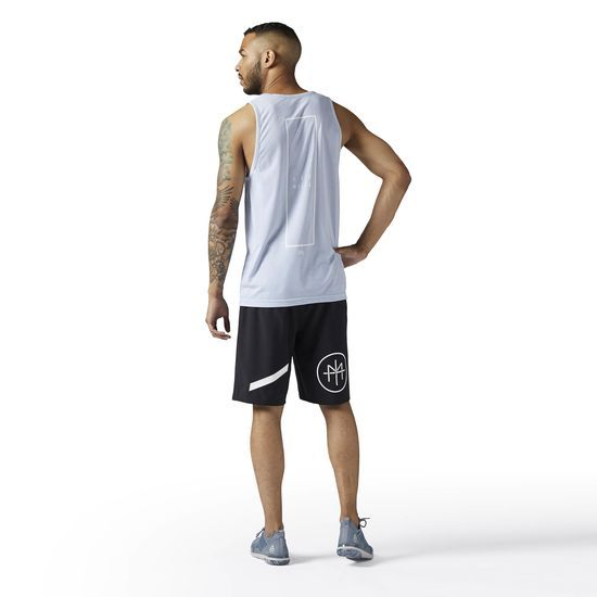 Reebok - LES MILLS Tank: Attack your next LES MILLS class with the moisture-zapping power of this men's tank. Speedwick technology keeps sweat off your body and mind, and the sleeveless construction helps you work your way to greatness.