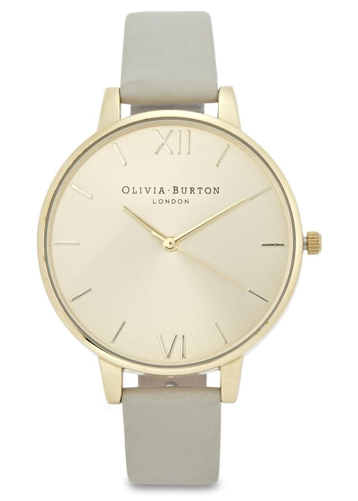 Olivia Burton gold plated watch Designer stamped face, Japanese quartz movement Buckle fastening grey leather strap Comes in a designer stamped box