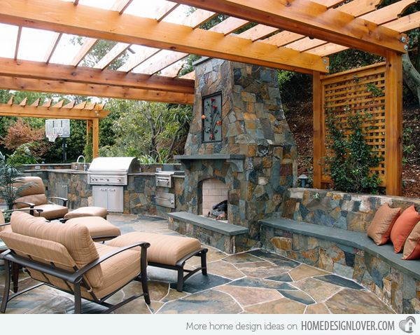 Outdoor kitchen inspiration, stone fireplace with integrated seating and bbq - Found on homedesignlover.com