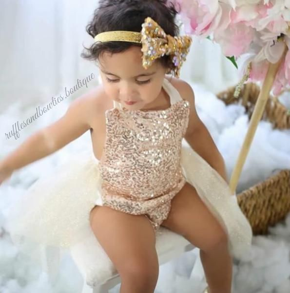 *Original Kryssi Kouture Design Exclusive to Ruffles & Bowties Bowtique* Does your little diva want to stand out in a crowd? This romper will do just that!