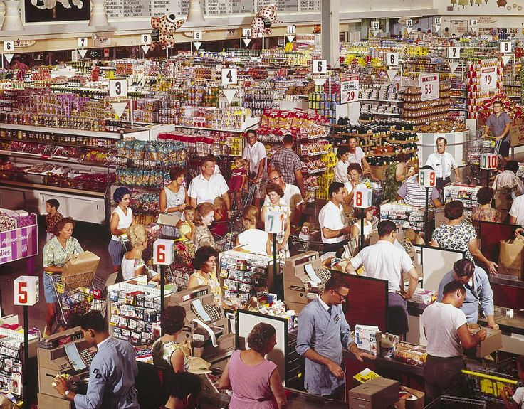 Super Giant grocery store 1964. click for enlargement & tons of details.  Hey, look at the guy  at the back of the line for aisle..8 or 7..can't tell. Anyway, he looks just like Blake Shelton to me. :)