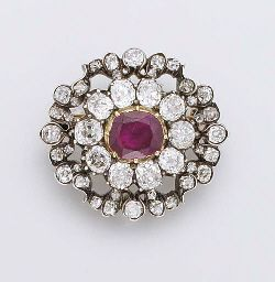 """Formerly in the collection of the French Crown Jewels, this brooch was part of the parure illustrated above, sold by Vanderheym, Bloche in France on 12th May 1887.   AN HISTORICALLY IMPORTANT ANTIQUE RUBY AND DIAMOND BROOCH   The central cushion-shaped ruby and old-cut diamond cluster to the diamond openwork surround, mounted in silver and gold, circa 1860, 2.8 cm. wide  Reverse engraved """"Vente des diamants de la Couronne Mai 1887"""""""
