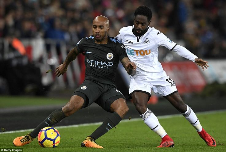 Fabian Delph, who was one part of a makeshift back four, is put under pressure by Swansea winger Nathan Dyer