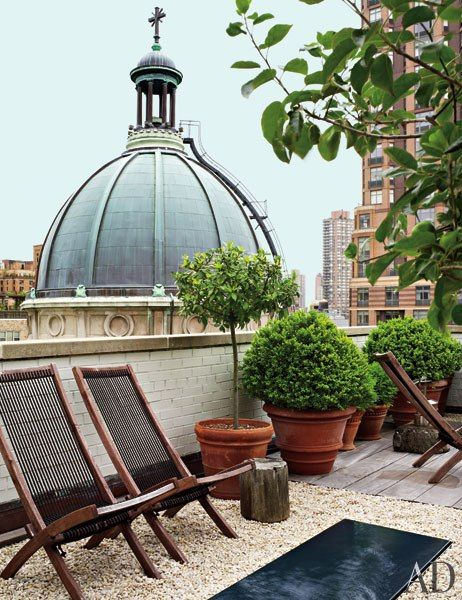 The terrace looks onto St. Jean Baptiste Church and is outfitted with terra-cotta planters by Seibert