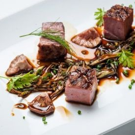 Chargrilled Gressingham duck breast with spring onion, pickled shiitake mushrooms, garden herbs and soy reduction.