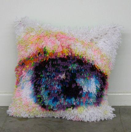 // Karl Hugo Erickson's latch-hooked eye pillows