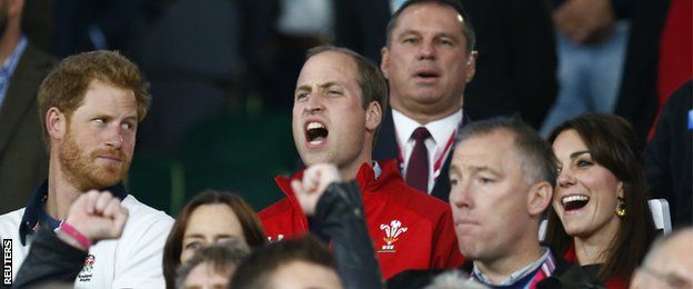 Prince Harry (left) looks critical as Prince William sings the Welsh national anthem before the England v Wales game in the 2015 World Cup