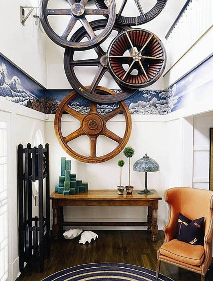 A striking display of worn ship's wheels in this contemporary apartment have steampunk influences.