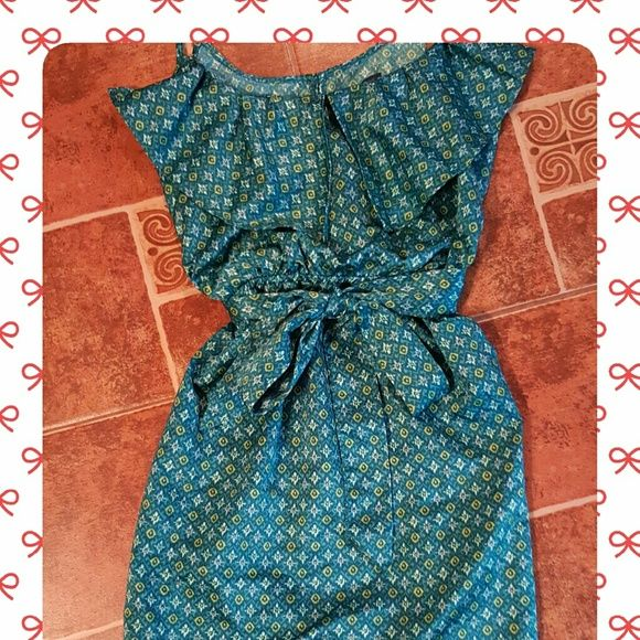 ♡♡♡Adorable Gap Dress Gap Dress made of 100% polyester with a soft sheen to it. Spaghetti straps and a tie in the front makes this teal green dress simply chic. NWOT GAP Dresses Mini