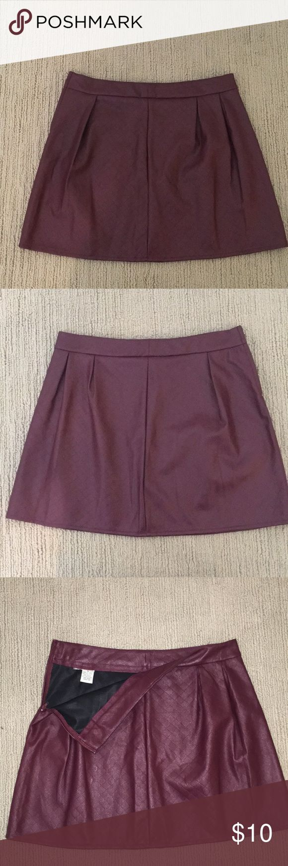 """Mimi Chica faux leather maroon skirt Faux leather maroon skirt! Great to dress up or down to the occasion. There was a larger tag, but it was itchy so I cut it off. The smaller tag (pictured) shows the brand name Mimi Chica. Bought at Nordstrom, only worn once. Goes about mid-thigh length for me, and I'm 5'11"""" Mimi Chica Skirts Mini"""