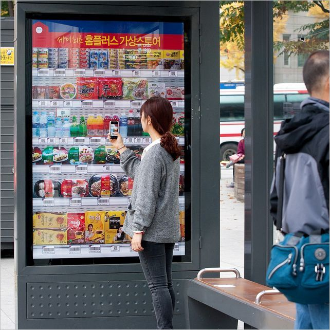 Tesco Homeplus is extending its virtual stores following the trial of QR Code shopping walls in Hangangjin subway station in Seoul, South Korea. Twenty bus shelters are to display a select few groceries that can be purchased for home delivery by scanning the appropriate QR Code with the Tesco Homeplus Smartphone App.