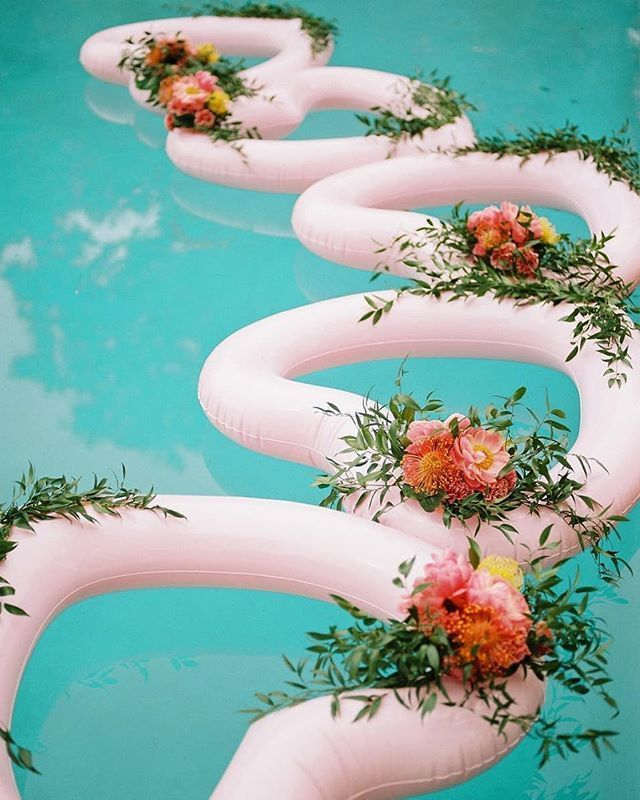 How stinkin' cute are these heart-shaped floaties laden with petals from a weddi