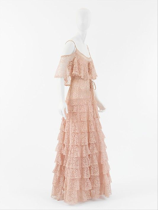 """Dress, Evening  House of Chanel  (French, founded 1913)    Designer:      Gabrielle """"Coco"""" Chanel (French, Saumur 1883–1971 Paris)  Date:      ca. 1930  Culture:      French  Medium:      a,b) silk  Dimensions:      Length at CB (a): 52 in. (132.1 cm) Length (b): 76 in. (193 cm)  Credit Line:      Isabel Shults Fund, 2004  Accession Number:      2004.447a, b"""