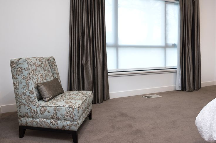 Occasional chair in blue and silver tones for master bedroom.
