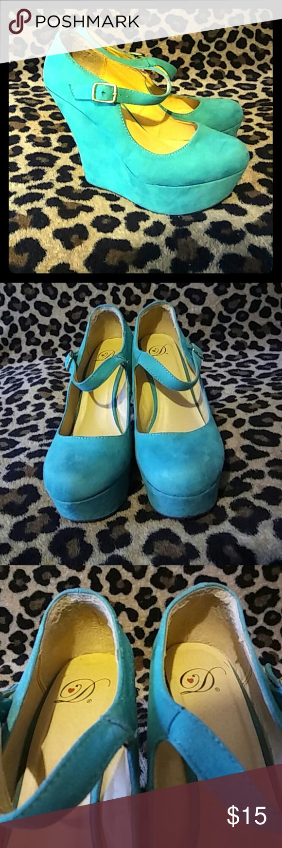 Blue Platform Wedges Good condition, D Heart brand platform wedges. They have some minor wear, as pictured. 5 inch wedge height. Shoes Wedges