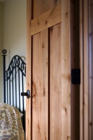 A 3 Panel Mission Style Knotty Alder door with oil rubbed bronze hinges and door handle.   Interior Gallery | Minnesota | Bayer Built Woodworks