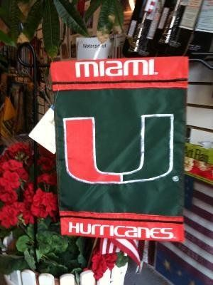 """Miami Hurricanes Flag 12.5"""" x 18"""" Garden Flag . $11.00. 100 % Polyester. 12.5"""" W x 18"""" L. Applique Flag. Machine Washable. Window Rod with Suction cups included. This is a 12.5"""" x 18"""" Officially licensed APPLIQUE Garden Flag of UNIVERSITY OF MIAMI HURRICANES. This Flag is of high quality. Each color is a seperate piece of material. It is not screen printed. Designed to hang vertically on a Garden Pole, inside as wall decor, or in a window using the window rod ..."""