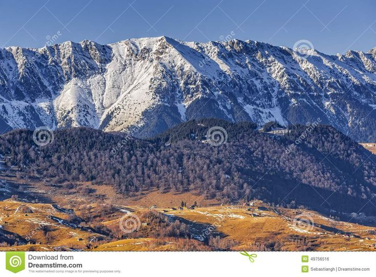 Landscape with snowy Piatra Craiului mountain ridge in the Piatra Craiului National Park, Brasov county, Romania. Travel destinations.