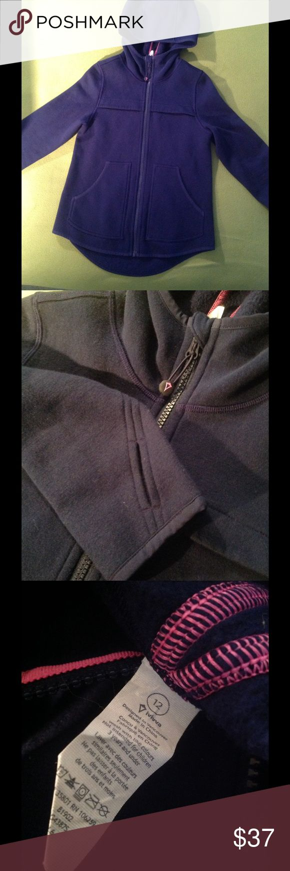 NEW IVIVVA JACKET - lululemon kids 12/2 New ivivva ( kids brand of Lululemon ) jacket! Never worn or washed, I bought this and it was too small for me. Kids 12 but is equivalent to a size 2 Lululemon. Ivivva symbol on back and zipper. Zipper can be removed and used as a hair tie! Thought this was cool 😎. Also, there are thumb holes ( great for cold weather ). This is a great jacket for winter or even ice skating! No pilling, stains or rips. Very cozy!!!  Let me know if you have any…