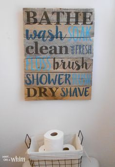 Bathroom Pallet Sign and Wire Basket for Toilet Paper  Vintage Farmhouse Bathroom Makeover   Denise on a Whim