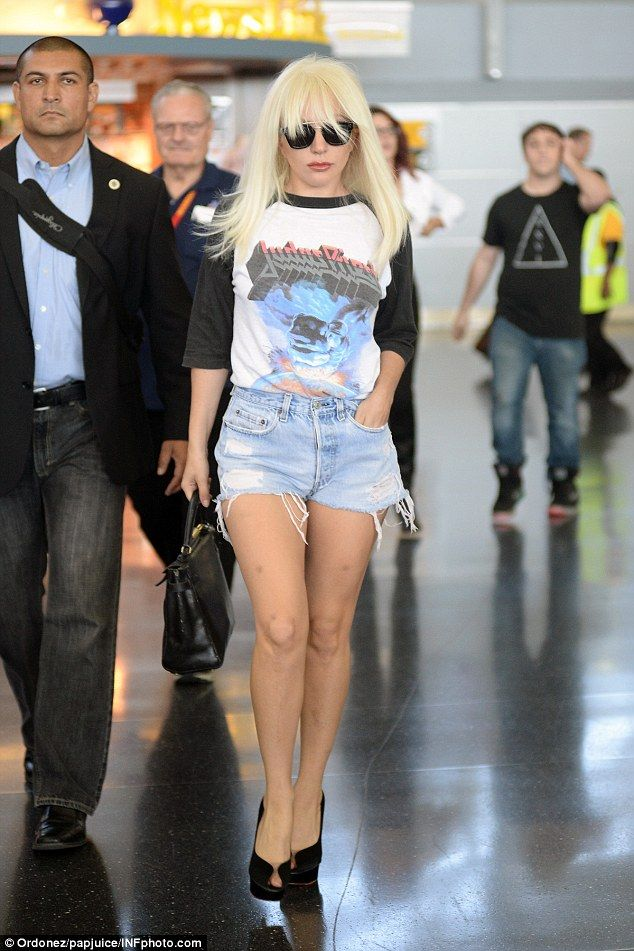Let's strut! Lady Gaga turned heads as she walked through arrivals at JFK airport on Tuesd...
