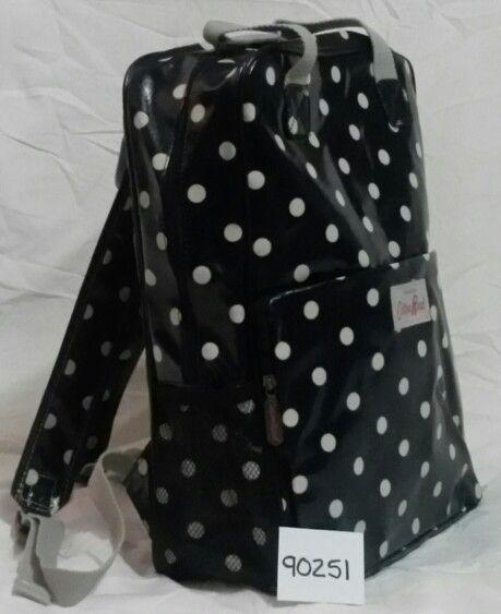 Dark blue polka dot backpack